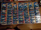 LOT OF 50 HOT WHEELS ASSORTED CARS FROM THE 2000S ALL IN PACKAGE 2