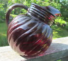 Vintage Fire King ruby red tilted swirl ball pitcher with ice lip