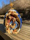 NATIVITY SCENE EGG WITH HOLY FAMILY WITHIN AND ANGELS SURROUNDING STAR ON TOP