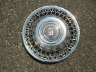 one 1986 to 1988 Oldsmobile Delta 88 wire spoke hubcap wheel cover