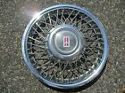 one genuine 1991 to 1994 Oldsmobile Cutlass Ciera wire spoke hubcap wheel cover