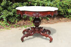 Striking Large Victorian Rococo Turtle Marble Top Center Table with Dolphin Base