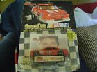 RACING CHAMPIONS 1991 TRACY LESLIE NASCAR STOCK CAR #72 W/CARD & DISPLAY STAND