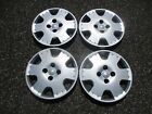 set of 4 genuine 2000 to 2005 Toyota Echo 14 inch hubcaps wheel covers beaters