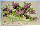 1910 POSTCARD BEST BIRTHDAY WISHES VICTORIAN LADYS SHOW FILLED WITH LILACS