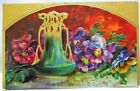 1910 POSTCARD BEST WISHES GREEN ART POTTERY VASE AND COLORFUL VIOLETSGOLD