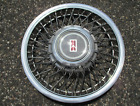 One NOS 1991 to 1994 Oldsmobile Cutlass Ciera wire spoke hubcap wheel cover
