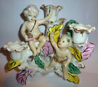 VINTAGE CHERUB PUTTI PORCELAIN CANDELABRA (Holds 3 one inch diameter candles)