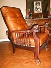 Antique Morris recliner chair mahogany lion head arms and paw feet side spindals