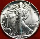 Uncirculated 1987 American Eagle Silver Dollar Free S H
