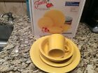 fiestaware  Four Piece Place Setting. Sunflower