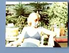 FOUND COLOR PHOTO S+9894 PRETTY WOMAN IN SWISMUIT SITTING IN CHAIR