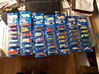 1990S HOT WHEELS BLUE CARD LOT OF 46 IN PACKAGE ASSORTED NUMBERS FROM 100 199