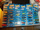 1990S HOT WHEELS BLUE CARD LOT OF 38 IN PACKAGE ASSORTED NUMBERS FROM 100 273