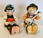 Vintage Made in Japan Boy Playing Instrument  Girl Reading Salt  Pepper Shaker