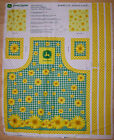 A JOHN DEERE BARBECUE APRON WITH POCKETS AND DAISYS COTTON FABRIC PANEL