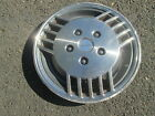 one 1986 to 1988 Pontiac 6000 14 inch hubcap wheel cover