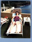 FOUND COLOR PHOTO S+6544 PRETTY WOMAN IN SWISUIT LAYING IN CHAIR