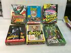 Lot of 6 boxes of Non-Sports Cards Dinosaurs Attack Rocketeer Bingo Desert Storm