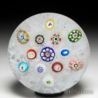 Antique Baccarat scattered millefiori and Gridel Silhouette canes paperweight