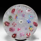 Baccarat spaced zodiac millefiori on upset muslin glass paperweight