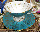 BAVARIA GERMANY TEA CUP AND SAUCER FOOTED BLUE & GOLD TEACUP PATTERN