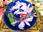 OCCUPIED JAPAN TEA CUP AND SAUCER PAINTED ORCHIDS PATTERN TEACUP BLUE