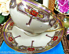 NIPPON TEA CUP AND SAUCER PAINTED FLORAL PATTERN BEADED GOLD TEACUP