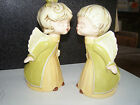 Two matching Ceramic Kissing Angels Hand Painted boy and girl