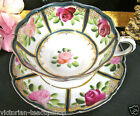NIPPON TEA CUP AND SAUCER PAINTED ROSES PATTERN BEADED GOLD TEACUP