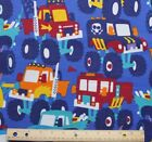 SNUGGLE FLANNEL BIG MONSTER TRUCKS on BLUE  100 Cotton Fabric BTY