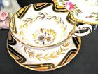 Grosenvor tea cup and saucer black and gold gilt floral  painted teacup