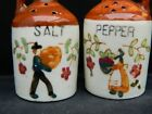 Vintage Salt  Pepper Shakers Figural JUGS with Farmer Farm Harvest Picture cork