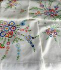 Vintage linen tablecloth with hand embroidered flowers in beautiful colours