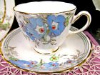 TUSCAN TEA CUP AND SAUCER PAINTED FLORAL BLUE TEACUP GOLD GILT TRIMS