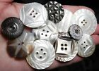 11 Medium and large Pearl/Abalone buttons with carving. 3/4 to 1