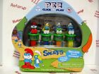 PEZ 4 Smurf PEZ dispensers in SMURF TIN with  6 BLUE Sour candy packs
