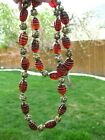 Vintage 34 Necklace Beads of Molded Red Glass and Ornate Gold Tone Accent Beads