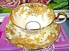 AYNSLEY tea cup and saucer cream base gold gilt lace floral pattern teacup 1920s