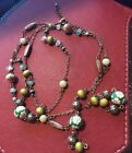 Vintage Glass beaded necklace Green is the main color but it has floral and plai