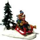 Lemax Village Figures 3 Children on Sled with Dog and Pine Tree Scene