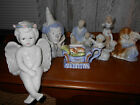 lot of 7 blue and white figurines  angels girls boys clown dogs