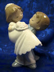 LOVE IS... YOU AND ME  GROOM HOLDING BRIDE COUPLE  FIGURINE NAO BY LLADRO  #1741
