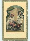 Edge Tear c1910 GIRL AND BOY WITH TOY WAGON DECORATED IN FLOWERS HL5555