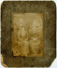 Vintage photograph haunting image of ghostly Victorian family cabinet card