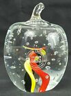 Antioch University Glass Paperweight w yellow black  red swirls and bubbles