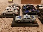LOT OF 13 ROAD CHAMPS POLICE SERIES SQUAD CARS UNITED STATES USA FORD CHEVROLET